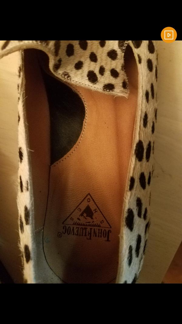 Size 6.5 animal print flats -- worn once!!!